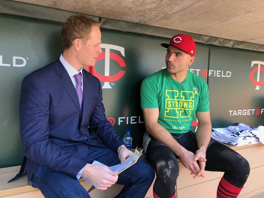 Cincinnati Reds 1B Joey Votto (Etobicoke, Ont.) chats in the dugout with former Minnesota Twins' slugger Justin Morneau (New Westminster, BC) who now works for the Twins Friday at Target Field in Minneapolis. Votto is wearing a Humboldt Strong t-shirt.A number of country artists and former NHLers are showing up for a Humboldt tribute Friday at SaskTel Arena in Saskatoon. Photo: Rob Butcher, Cincinnati Reds.