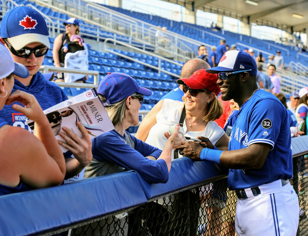Outfield prospect Anthony Alford, shown here signing autographs for fans in Dunedin this spring, was called up by the Toronto Blue Jays on Saturday. Photo Credit: Amanda Fewer