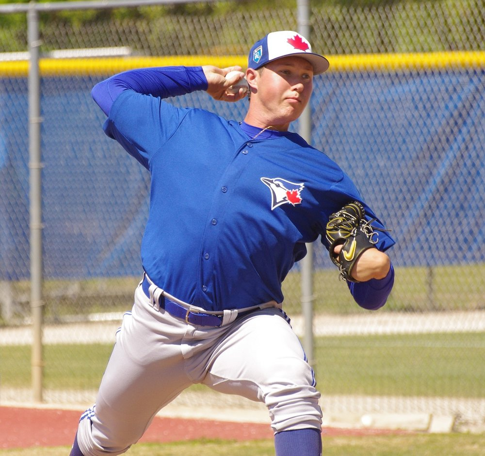 Toronto Blue Jays prospect Nate Pearson suffered a non-displaced fracture of the ulna in his pitching arm when he was hit by a line drive on Monday night. Reports indicate he'll be re-evaluated in four-to-six weeks. Photo Credit: Jay Blue