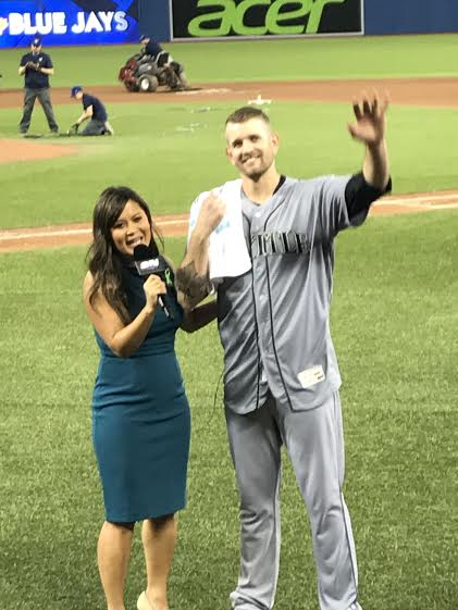 Paxton waves to the crowd after being interviewed by Hazel Mae following his no-no.