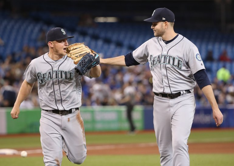 Paxton congrats Kyle Seager after he robbed Kevin Pillar of a base hit down the third base line in the seventh inning on Tuesday.