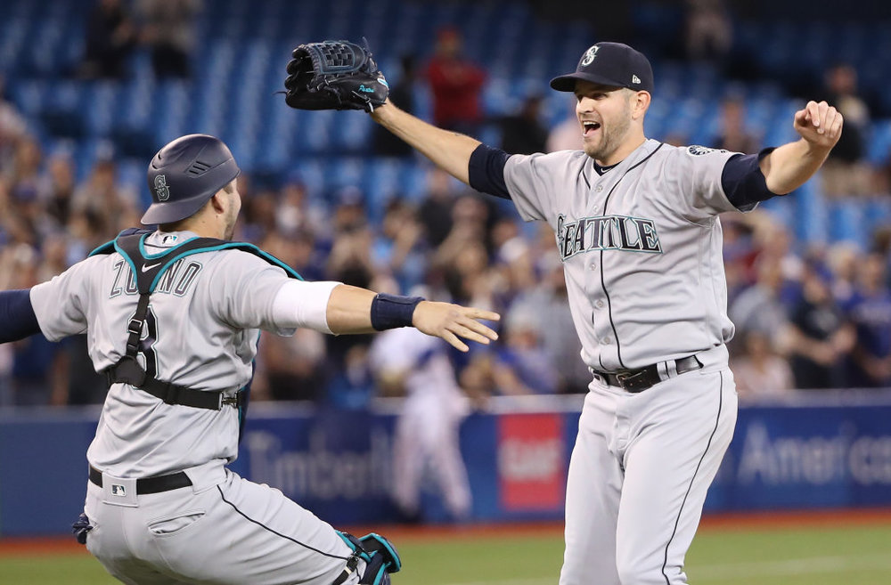 C Mike Zunino and Paxton celebrate at the Rogers Centre.