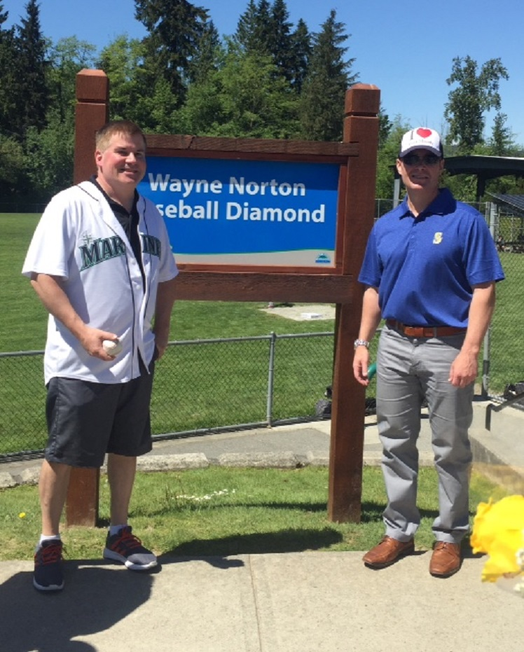 Mayor Mike Clay, left, and Seattle Mariners director of international scouting, Tim Kissner, were on hand in Port Moody, BC as Westhill Park was re-named the Wayne Norton Baseball Diamond.