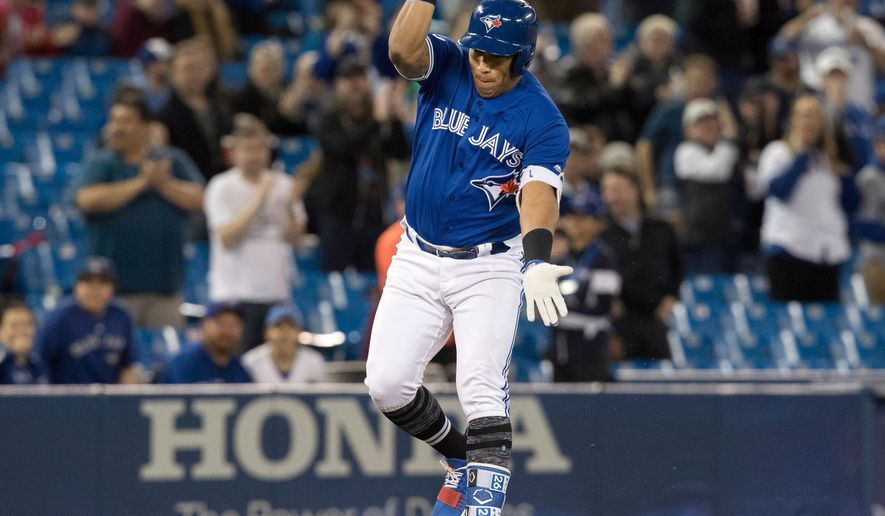 Toronto Blue Jays infielder Yangervis Solarte celebrates as he rounds third after hitting a two-run home run against the Kansas City Royals. Photo: The Legendary Fred Thornhill, The Canadian Press.