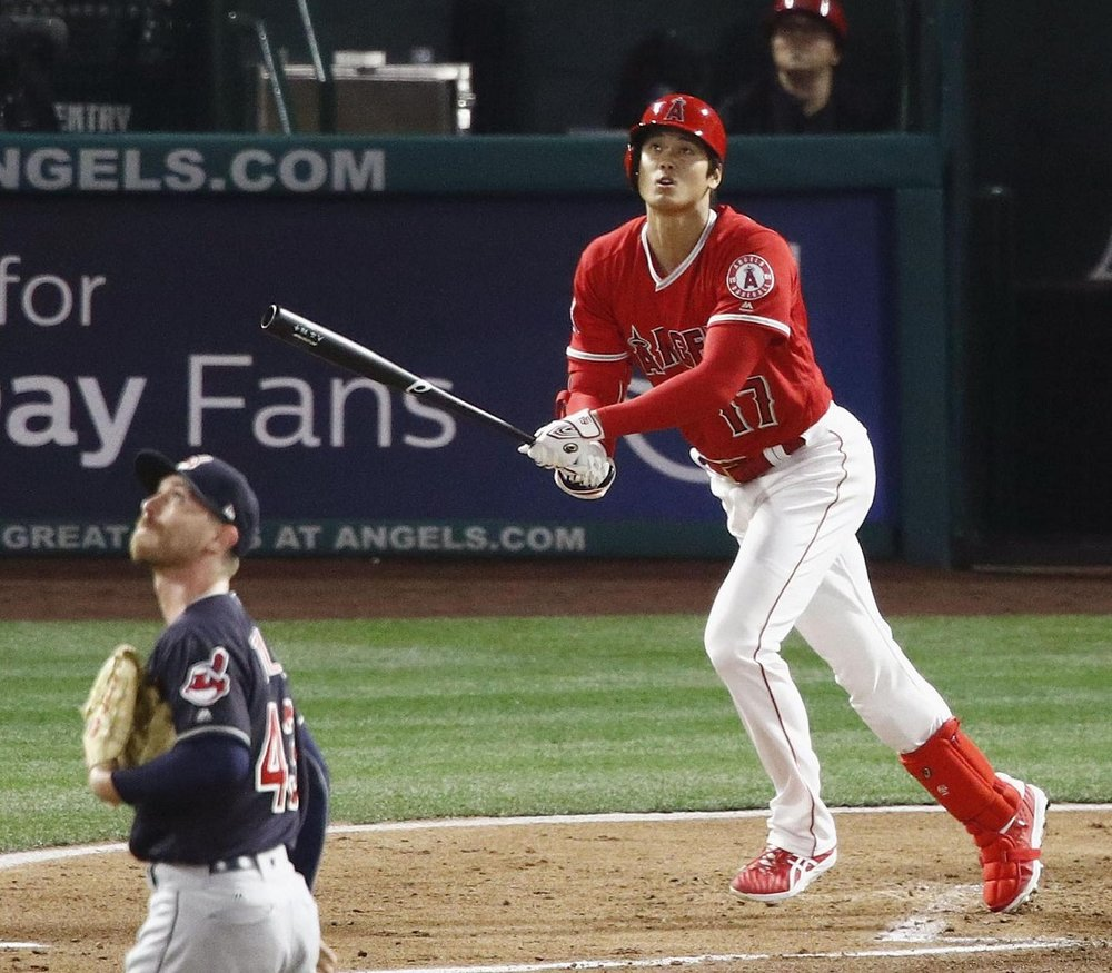 Shohei Ohtani homered in his first at-bat in the Los Angeles Angels home opener as he took Josh Tomlin of the Cleveland Indians deep.