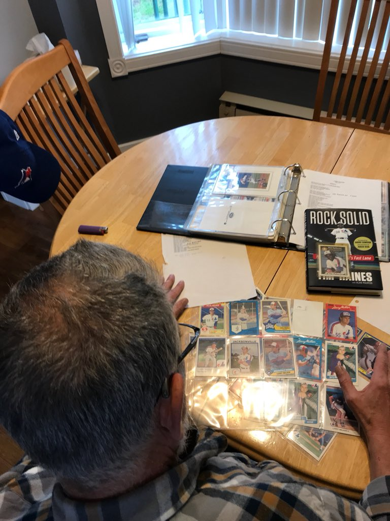 Steve Whitzman sorts through a selection of cards from his extensive Montreal Expos collection. Photo Credit: April Whitzman