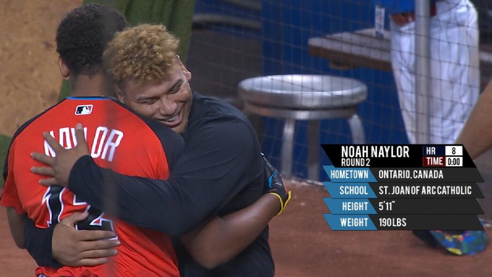 Noah Naylor finishes his round in the Junior Home Run Derby in Miami last July at Marlins Park, and is hugged by older brother Josh Naylor, in town for the Futures Games. Father Chris Naylor has the picture.