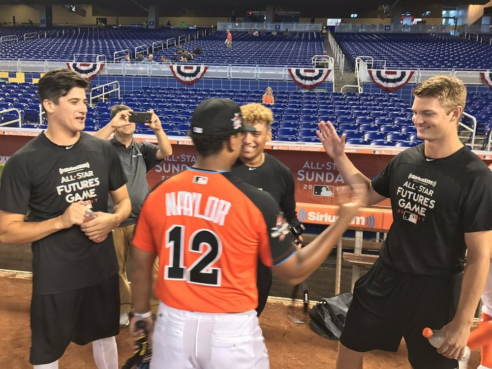 Canuck World Futures Games members, left to right Cal Quantrill (Port Hope, Ont.), Josh Naylor (Mississauga, Ont.) and Mike Soroka (Calgary, Alta. congratulate Noah Naylor after his run at the Junior Home Run Derby.