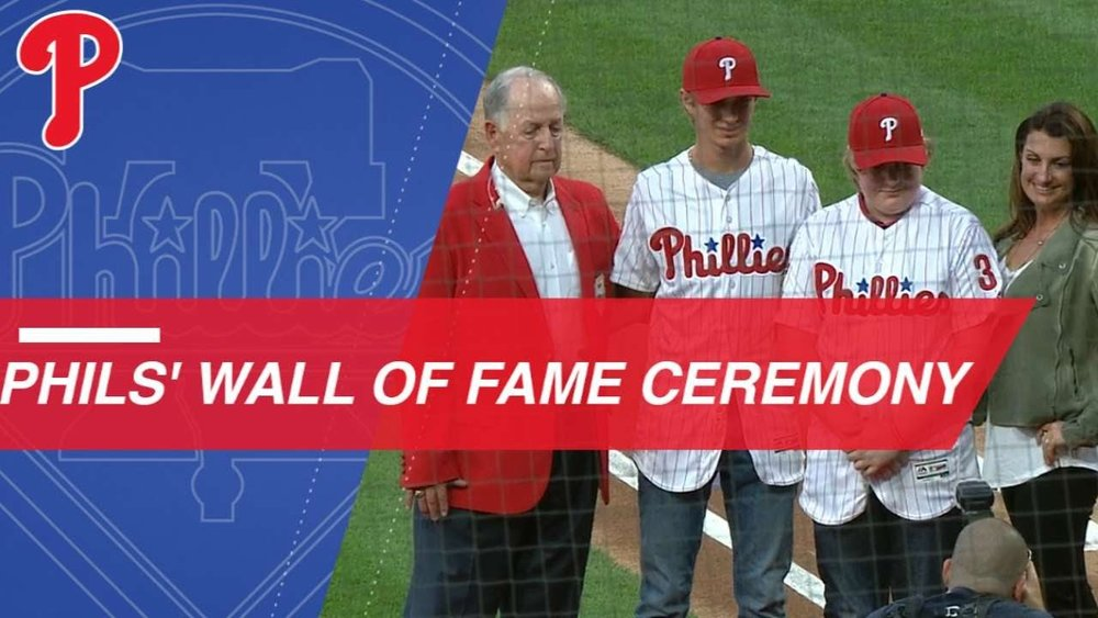 Pat Gillick, with Roy Halladay's sons, Braden and Ryan along with mom Brandy Halladay.
