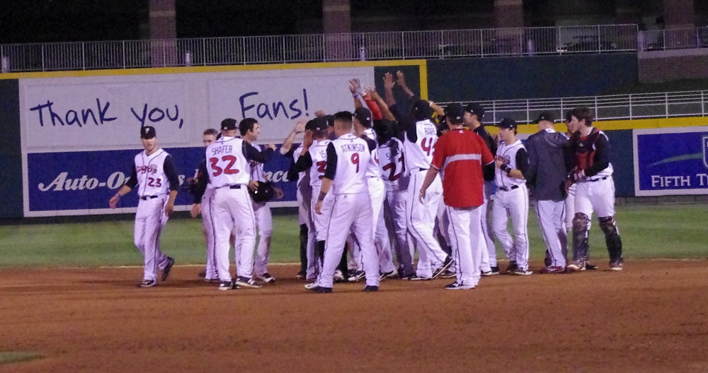 The low-a Lansing Lugnuts celebrate after ousting the Great Lakes Loons in the first round of the Midwest League playoffs in 2015. Photo Credit: Jay Blue