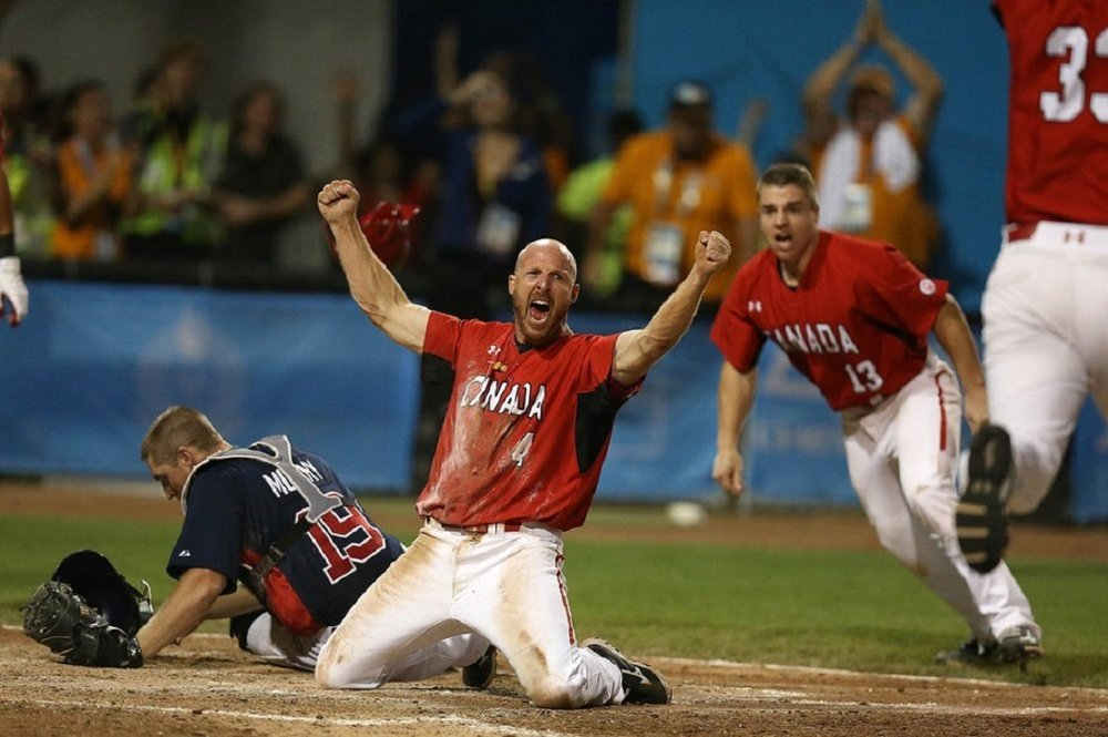 The popular Peter Orr (Richmond Hill, Ontt.), former Ontario Blue Jay, scores the gold medal winning run in the 2015 Pan Am Games in Ajax.