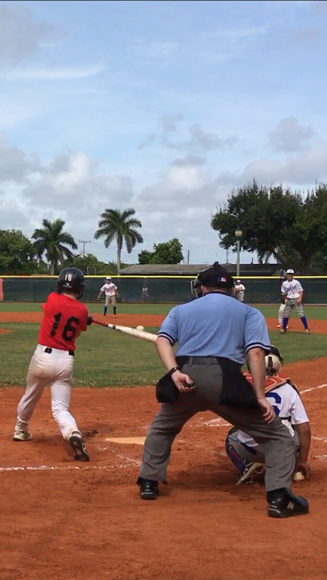 Rocky Johnson displays his grand slam swing at the International tournament at the Palm Beaches, Canada 12U.