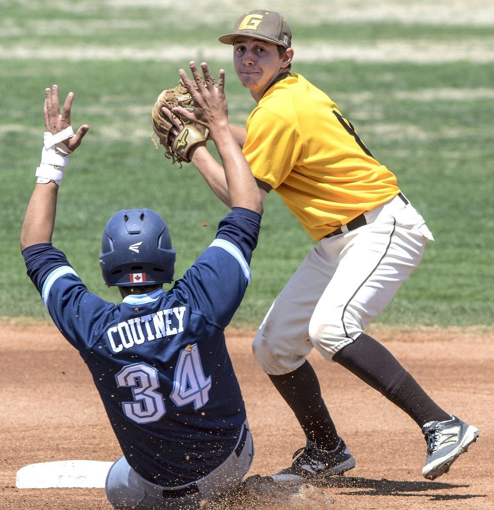 Parkland Twins grad Matt Coutney (Edmonton, Alta.) of the Colby Trojans slides into second.