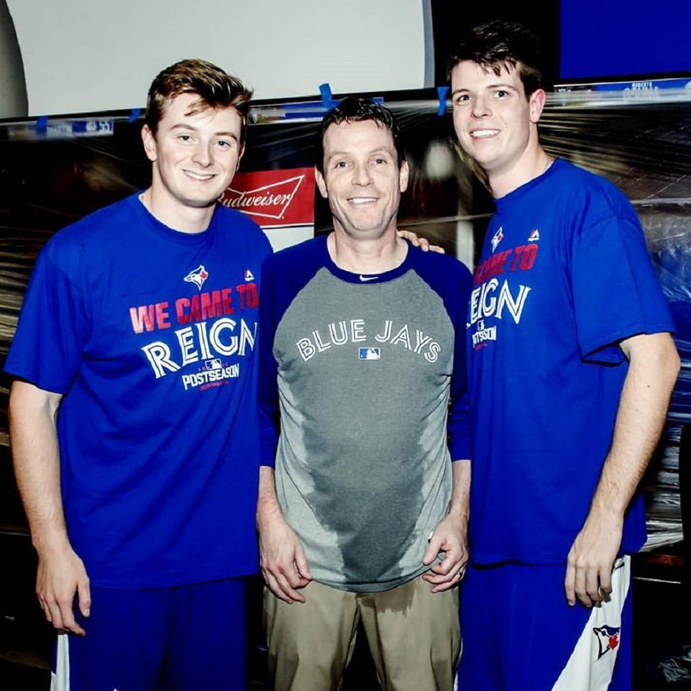 Cody Malloy, left, with father Kevin Malloy and brother Brendan, hours after Edwin Encarnacion hit a walk-off homer against the Baltimore Orioles as the Jays advanced to the American League Division Series and the champagne had been spritzed.