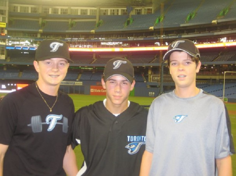 Cody Malloy, left and Brendan Malloy, right, with Nick Jonas, who stopped by the Rogers Centre to take batting practice.