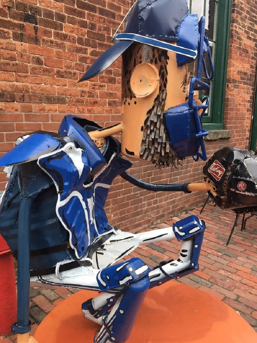 THERE ARE ZERO STATUES OF BALL PLAYERS NEAR THE ROGERS CENTRE, BUT THERE IS A SCUPTURE OF RUSSELL MARTIN IN FRONT OF CAYLEIGH PARRISH'S THE SPORT GALLERY IN THE DISTILLERY SECTION. HE AND JOHNNY BOWER GUARD THE DOORS. PHOTO: WAYNE PARRISH STUDIOS.