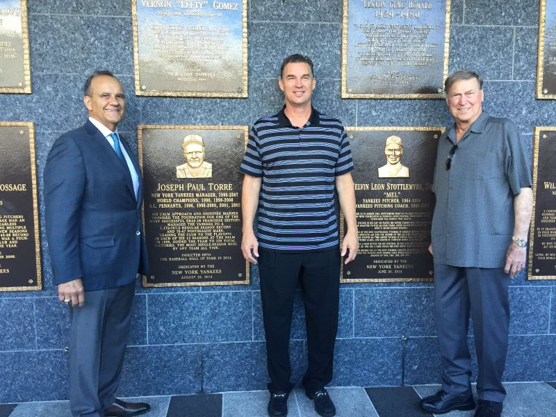 Former Toronto Blue Jays pitcher Todd Stottlemyre (middle) had the opportunity to visit Monument Park at Yankee Stadium with his dad, Mel, (right) and Joe Torre (left). Mel Stottlemyre's plaque can be seen between Stottlemyre and his dad. Photo Credit: Todd Stottlemyre