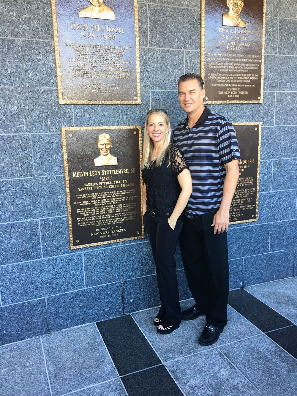 Todd Stottlemyre and his wife, Erica, beside his father's plaque in Yankees' monument park.
