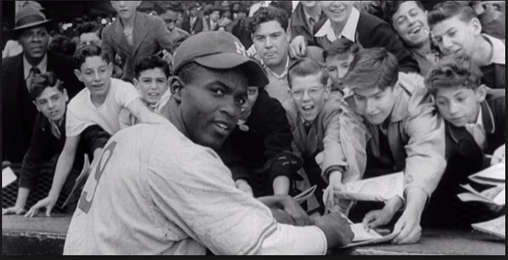 Jackie Robinson signing autographs for fans during the 1946 season with the Montreal Royals. Photo Credit: Montreal Royals (@Royals_46season) on Twitter
