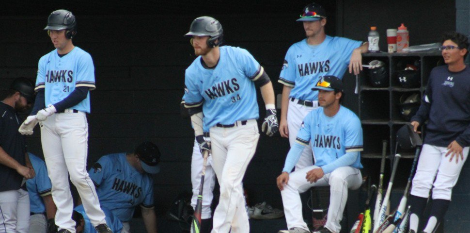 Victoria Mariners alum Tyler Schindel (Victoria, B.C.) (centre) was 6-for-10 (.600 batting average) for San Diego Christian.
