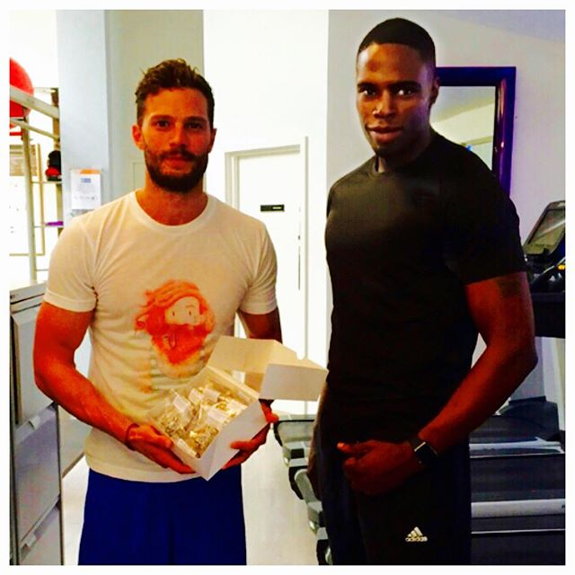 "Soooo... Client @jamiedornan is back from a well deserved vacation. Tanned, stronger, fitter than ever and jumps straight back into training the right way, the @rds_pro way! But first... ""Raheem Glistens 'Let me get some @rdsprotein coconut protein balls"" #Legend #RDSPRO #JamieDornan💪🙌 🙌💪"