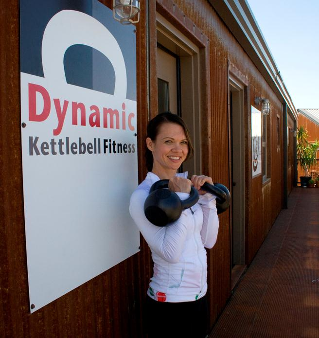 Keira standing outside the original location of Dynamic Fitness.