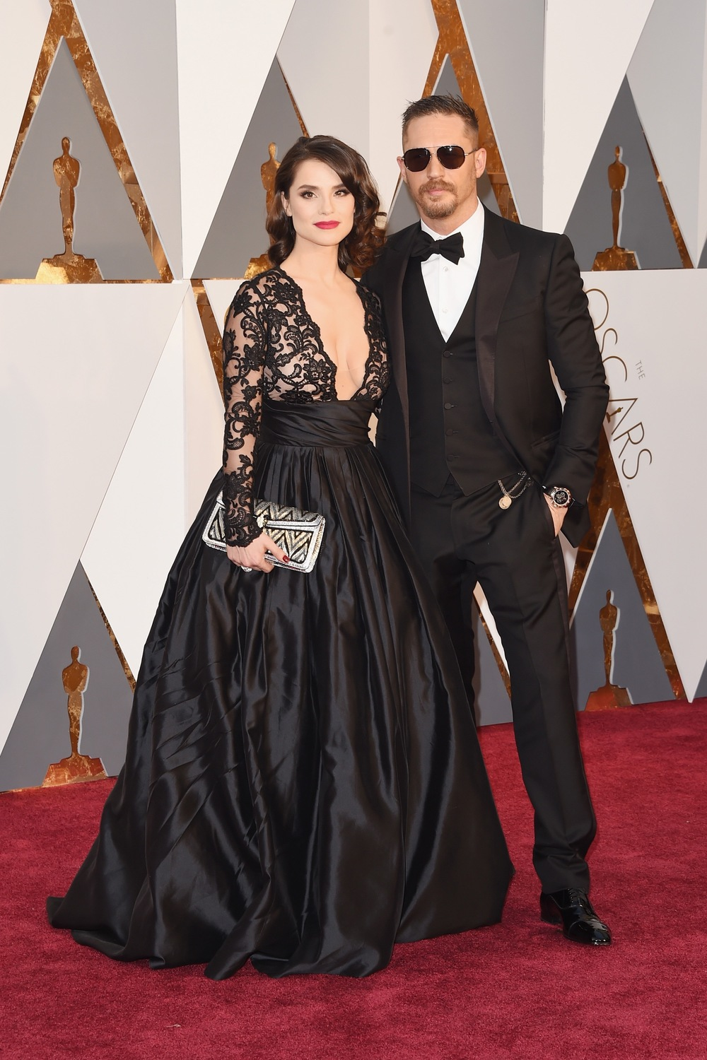 Charlotte Riley in Gauri & Nainika and Tom Hardy in Gucci at the 88th Annual Academy Awards