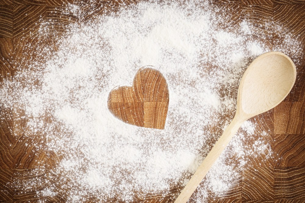 bigstock-Heart-of-white-flour-on-a-wood-80784047.jpg