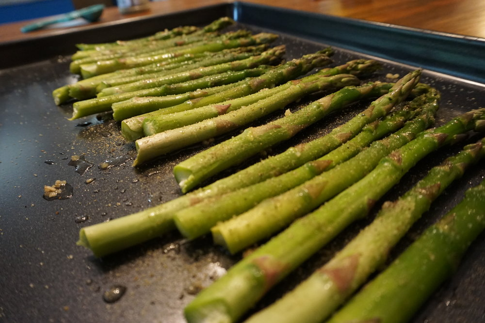 Quick Oven Asparagus - Need something healthy that does not take much prep time or cooking time?Then this is the side dish for you. One of our very own go to dishes that is a family favorite. Easy and minimal prep time and takes hardly any time in the oven. Let us know what you think!