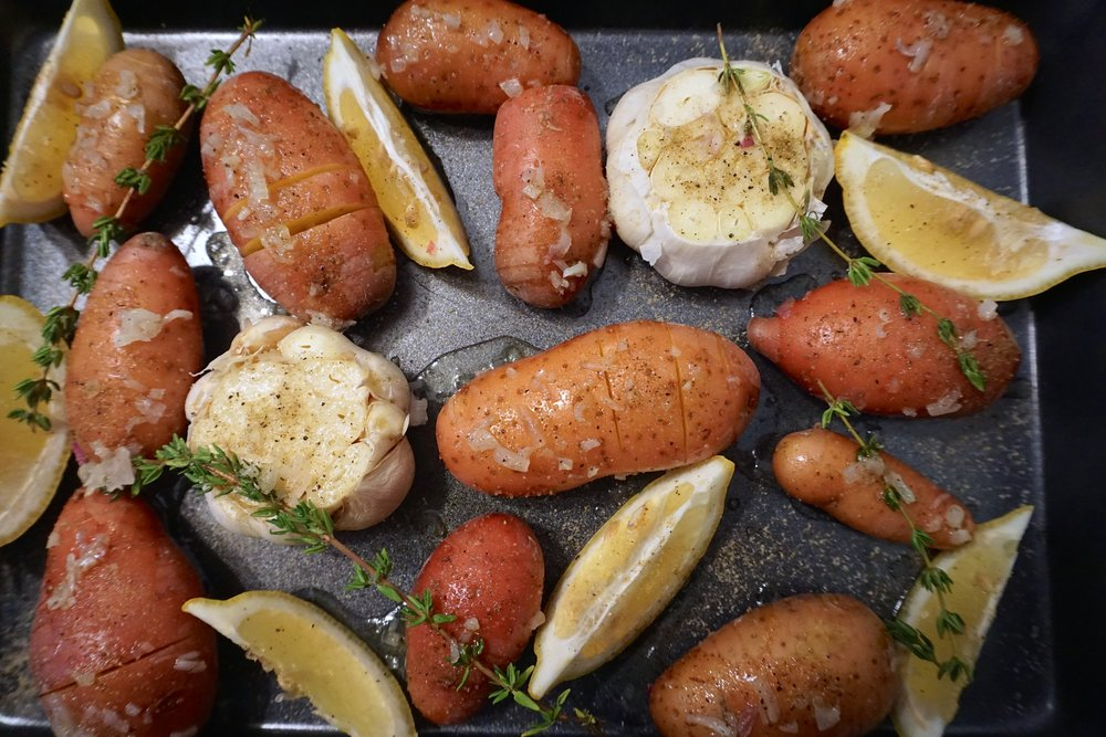 Lemon Garlic Roasted Potatoes - Fresh and light tasting potatoes cooked in the oven. So just prep and leave the oven to do the hard work for you