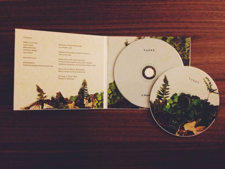 """Inside the album: Since the disc was placed on all the greenery, it needed to be blank because it screams """"pick me up baby"""" also, more greenery would've been overkill."""
