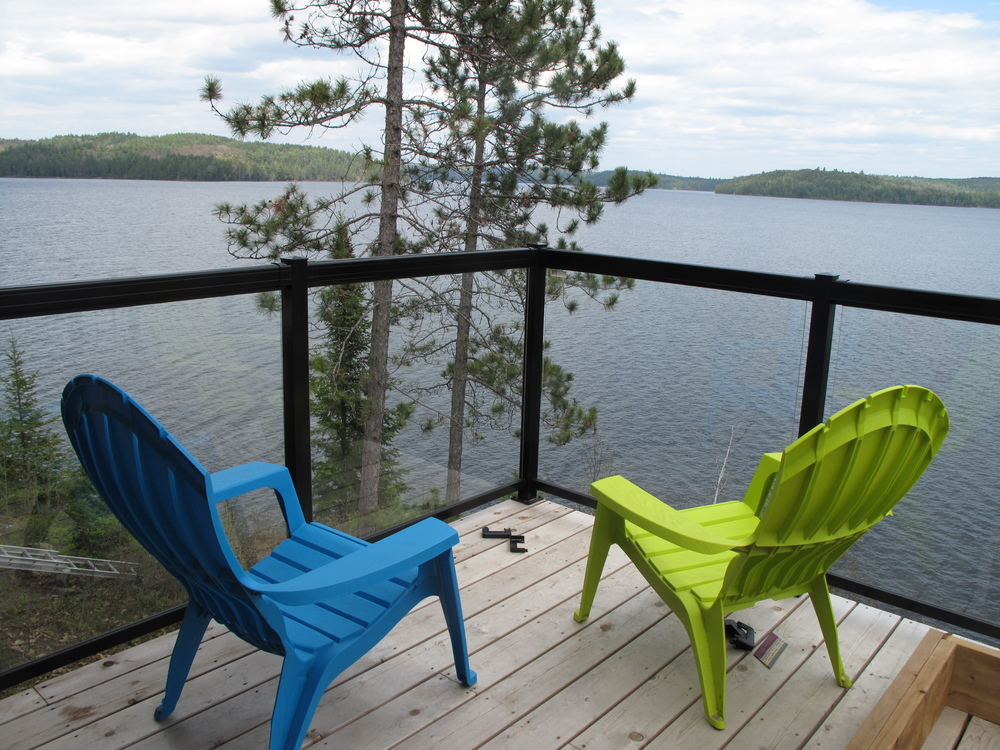 Cheryl & Leo's front deck with coloured chairs.JPG