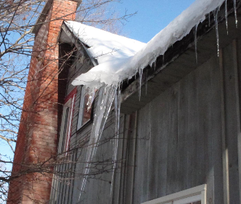 Ice damming due to improperly installed insulation