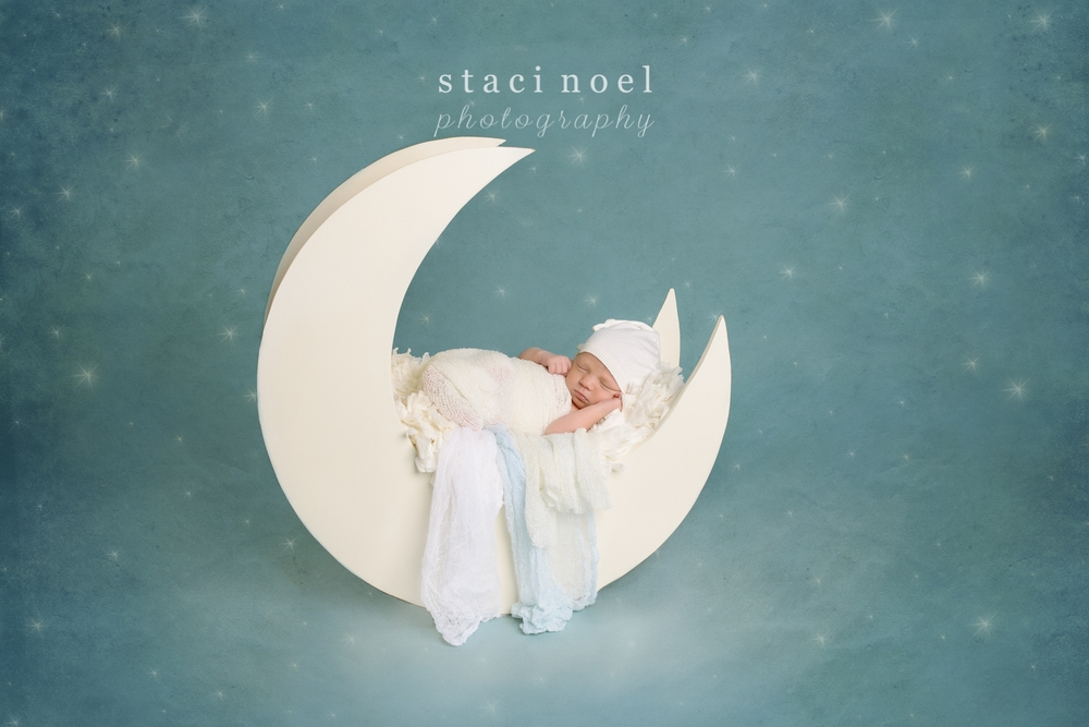 Charlotte newborn photographer Staci Noel photographys newborn baby boy in moon prop on night sky backdrop
