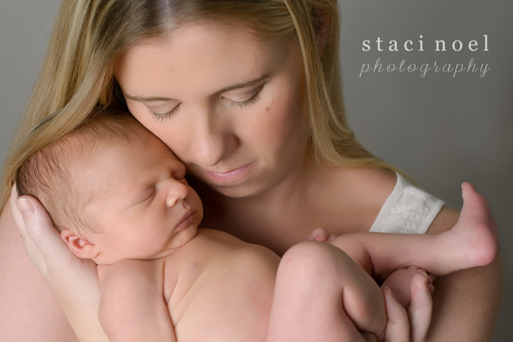 Charlotte NC newborn baby boy photographed in his mother's arms by Staci Noel Photography