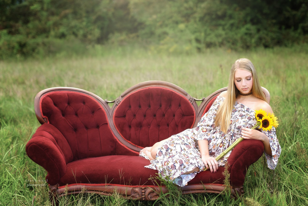 staci noel photography portraits of high school senior girl in dress in a summer field in Harrisburg NC on a red sofa