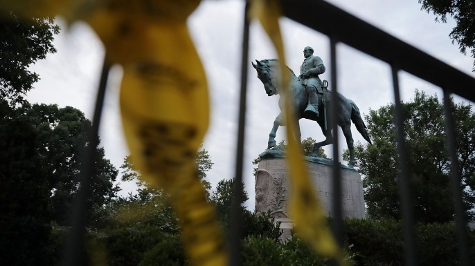 The statue of Confederate Gen. Robert E. Lee in the center of Emancipation Park the day after the Unite the Right rally devolved into violence August 13, 2017 in Charlottesville, Virginia. The Charlottesville City Council voted to remove the statue and change the name of the space from Lee Park to Emancipation Park, sparking protests from members of the 'alt-right.' (Credit: Chip Somodevilla/Getty Images)