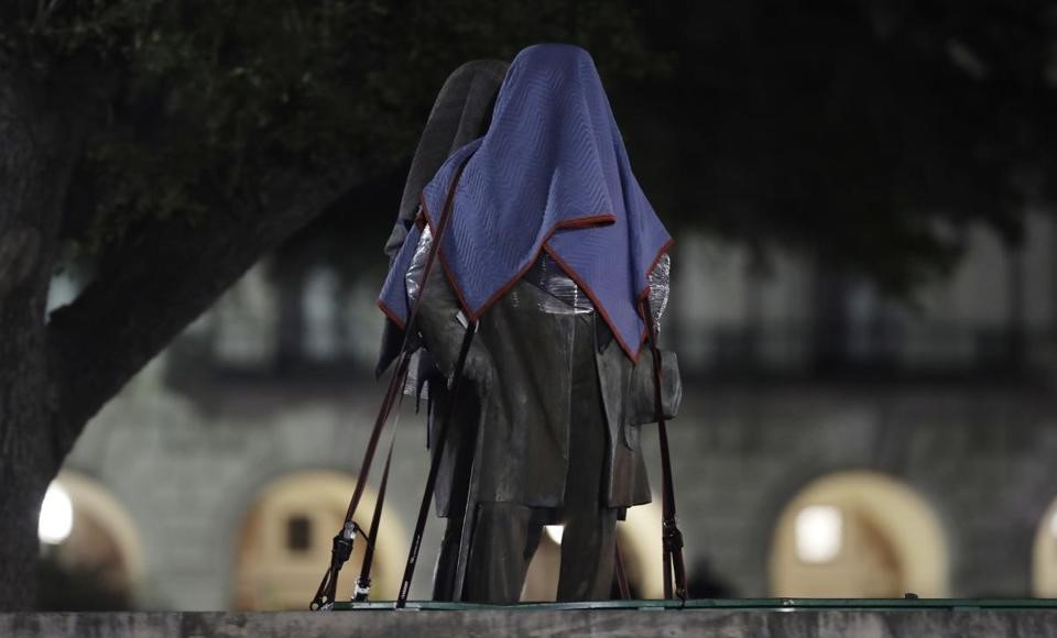 Confederate statues removed from the University of Texas's campus in Austin were secured to a trailer early Monday.    ERIC GAY/ASSOCIATED PRESS