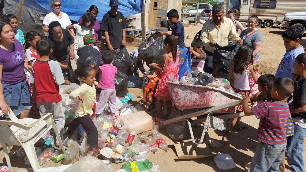 1harvest kids mexico crushing plastic.jpg
