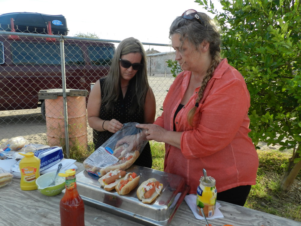 10Angie and Cassie putting some hotdogs together.JPG