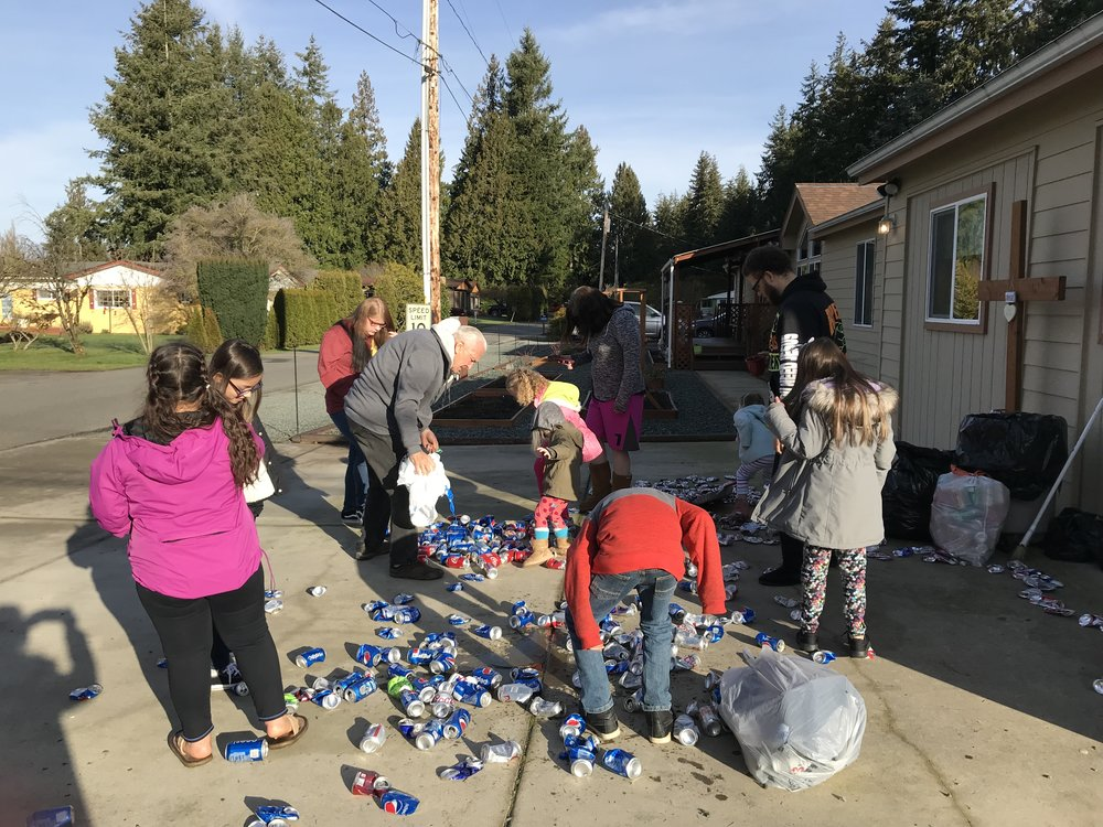 hARVEST KIDS CRUSHING CANS FOR CHILDREN IN AFRICA