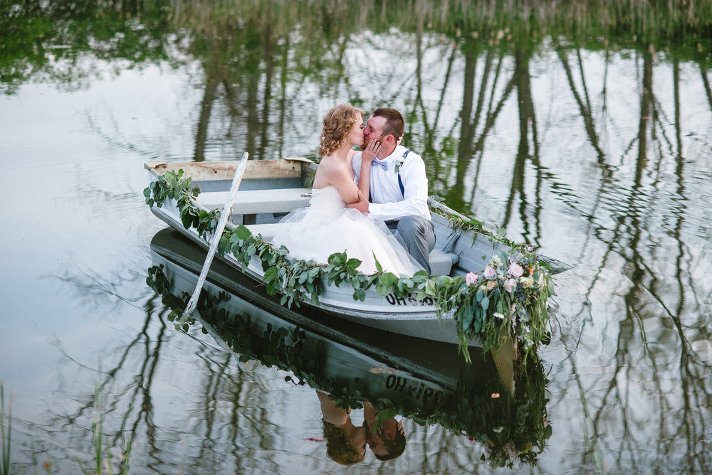 Wedding on the water? Definitely take advantage and sneak in some quiet kisses just the two of you in a boat!