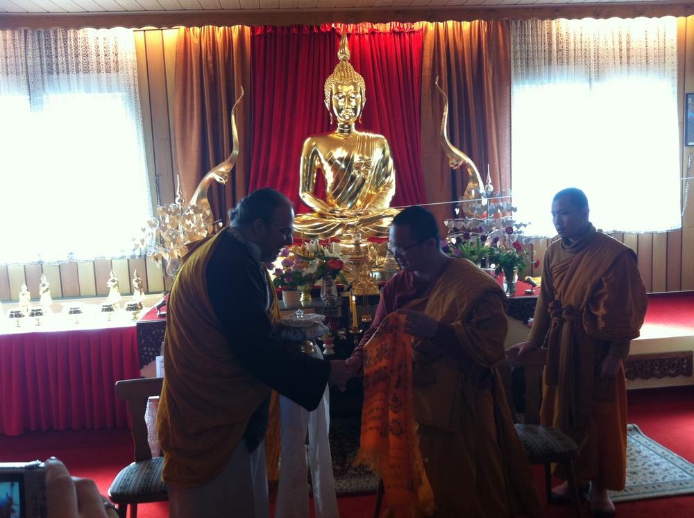 Wat Buddha Vipassana - Lama Receiving Relic.JPG