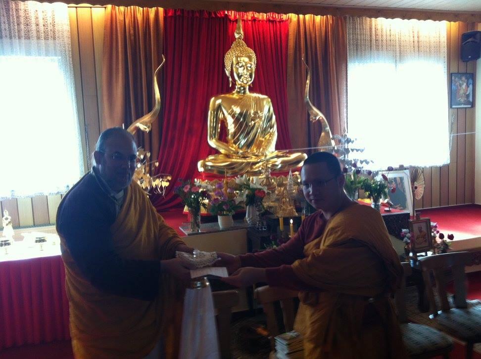 Wat Buddha Vipassana - Recieving Alms Relic.jpg