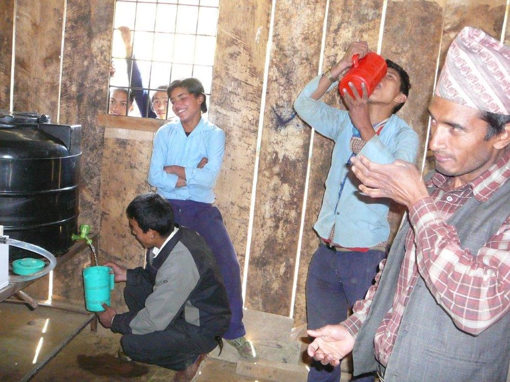 School children tesating the treated water.jpg