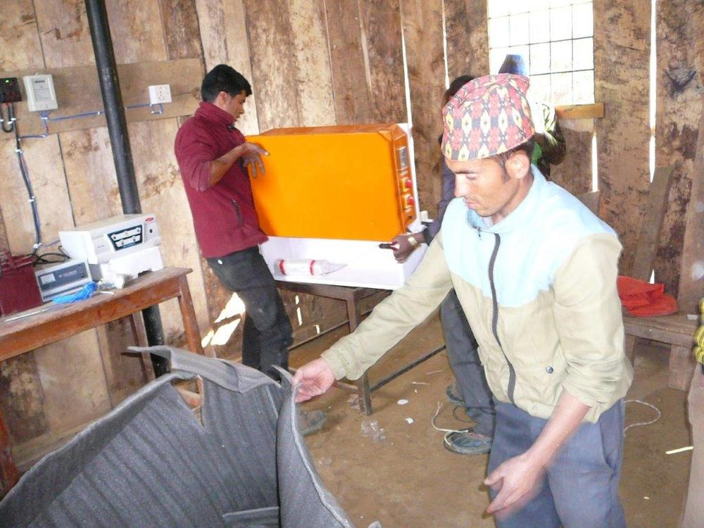 Setting up SPOWTS system at Munavedi school of Pasavar.jpg