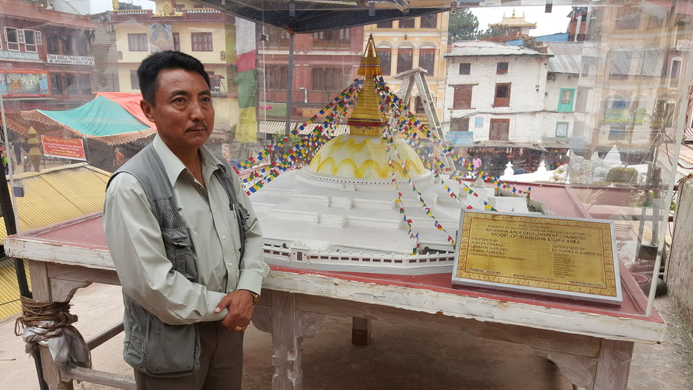 A model of the entire stupa with Kirin Lama of the Gyang Guthi