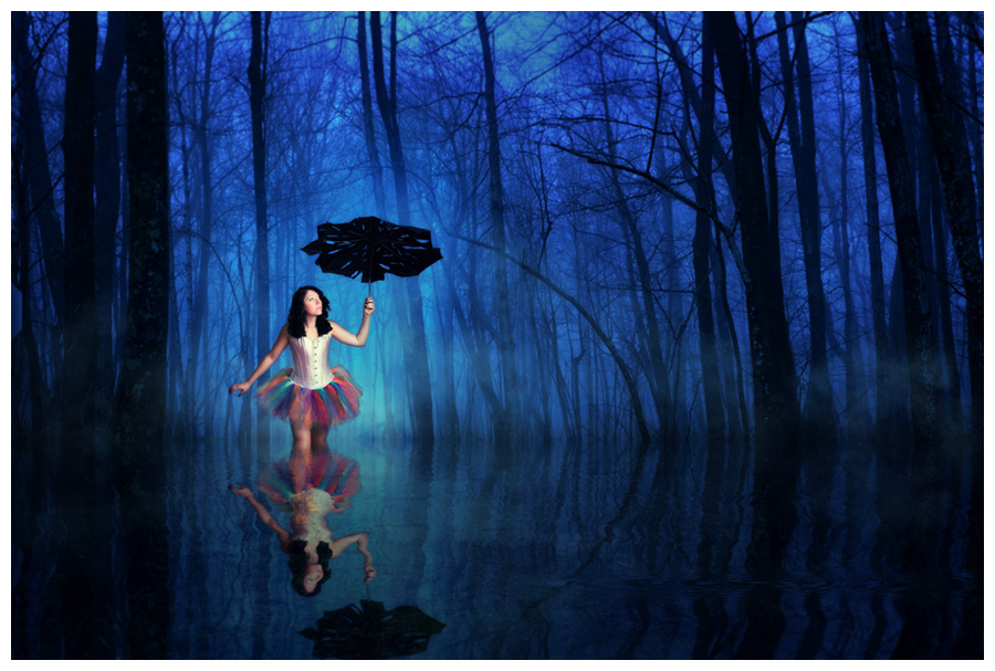 A composite of Fro wandering through a flooded forrest with a tattered umbrella in a rainbow tutu. One of many conceptual images from Fro's rockstar senior session at McClanahan Studio in Ames, IA!