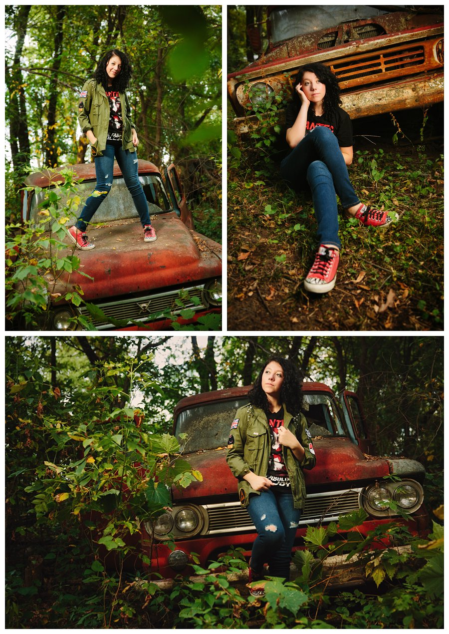 Senior portraits in an overgrown junkyard with a rusty red truck that match Fro's red converse. Attitude, sassafras and style during a central Iowa photo session with McClanahan Studio.