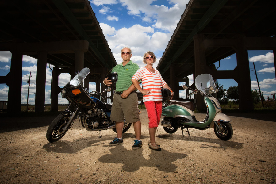 Alex's parents Dave and Barb rocking out with their motorcycle and scooter under the I-74 bridge in Davenport, IA